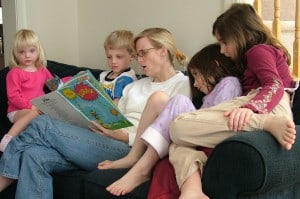homeschool mom reading on couch